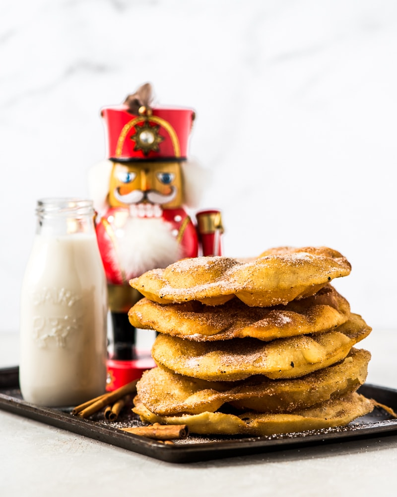 Often served during the Christmas and New Years holidays, this Mexican Bunuelos recipe makes the perfect fried dough covered in cinnamon sugar!
