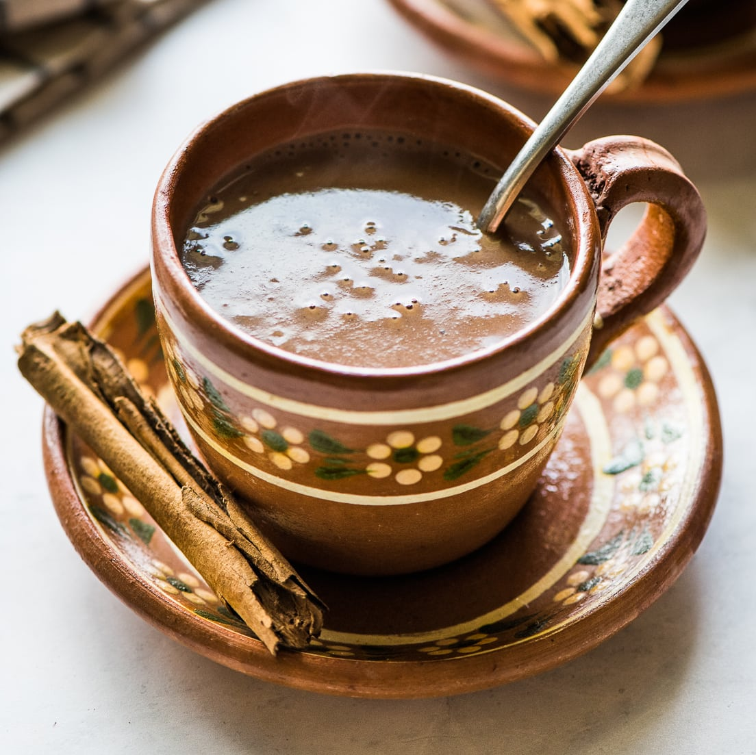 Champurrado - Looking to spice up your holiday menu? These 12 Mexican Christmas food recipes are perfect for celebrating Las Posadas, Noche Buena and Navidad!