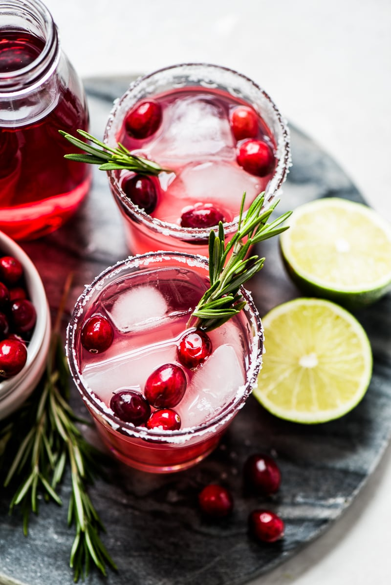 Filled with holiday cheer, this insanely Easy Cranberry Margarita will definitely get your Christmas party started. (gluten free, vegetarian, vegan)