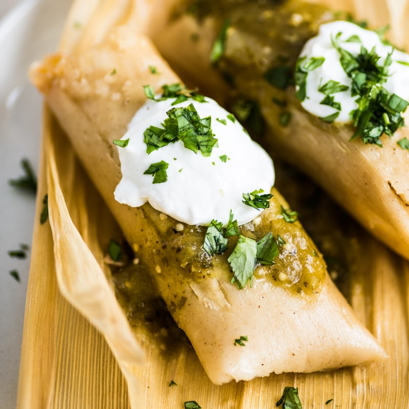 Green Chile and Cheese Tamales - Looking to spice up your holiday menu? These 12 Mexican Christmas food recipes are perfect for celebrating Las Posadas, Noche Buena and Navidad!