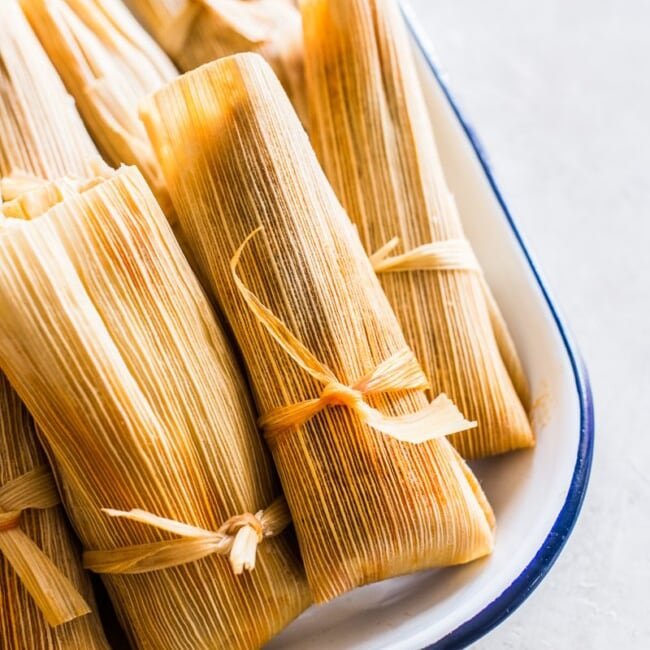 Red Pork Tamales - Looking to spice up your holiday menu? These 12 Mexican Christmas food recipes are perfect for celebrating Las Posadas, Noche Buena and Navidad!