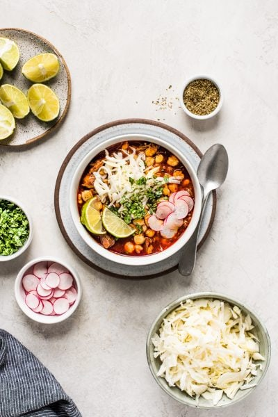 This Red Posole Recipe is a comforting Mexican stew filled with shredded pork and hominy in a warm red chile broth. It's easy to make and full of authentic Mexican flavor!