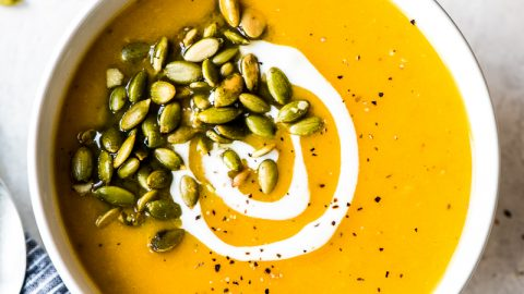 Roasted butternut squash soup in a white bowl.
