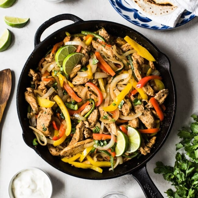 Limited on time? Make these healthy and easy Chicken Fajitas in only 30 minutes for a quick and delicious Mexican dinner tonight!