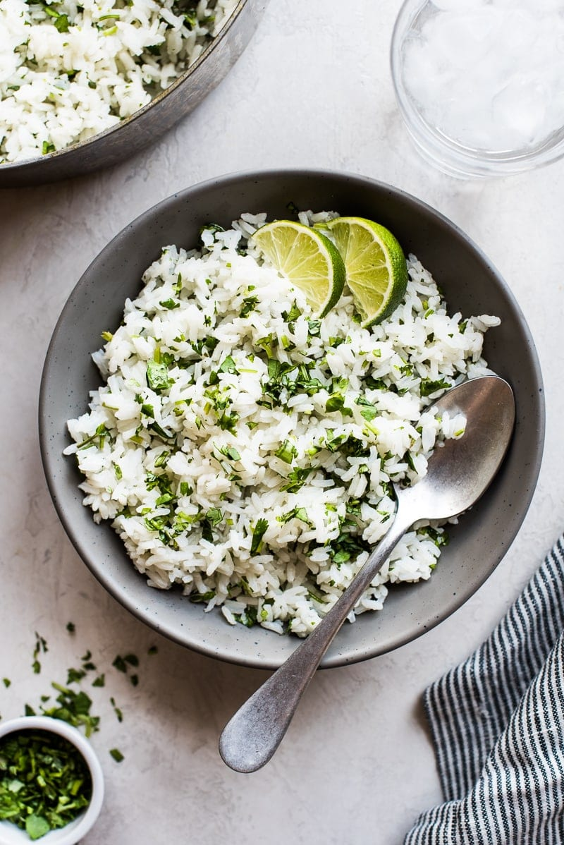 Overhead photo of Cilantro Lime Rice in a bowl with a spoon