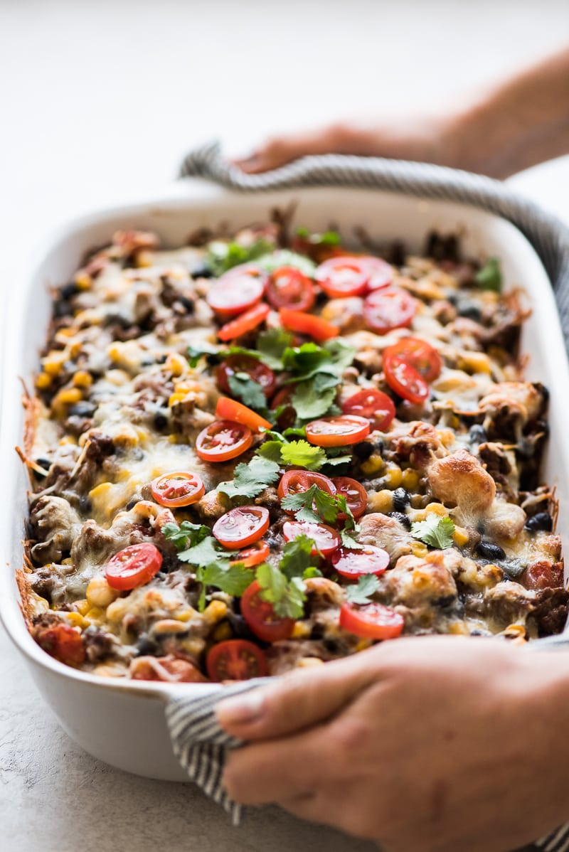 This Easy Taco Casserole (also known as Taco Lasagna) is made with 3 layers of corn tortillas, ground beef, corn, black beans, the best taco seasoning and lots of melted cheese!
