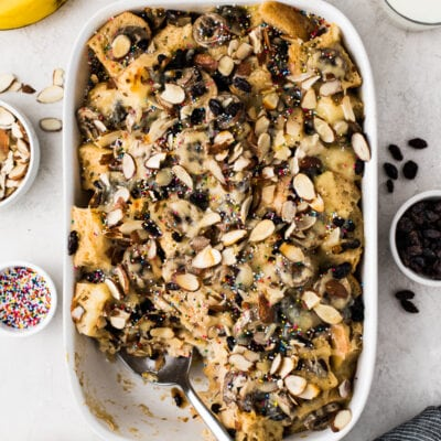 Capirotada topped with raisins, almonds and sprinkles.
