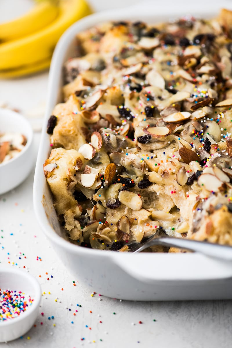 Capirotada, or Mexican Bread Pudding, is made with layers of crusty bread, raisins, bananas, almonds and cheese all soaked in sweetened milk!