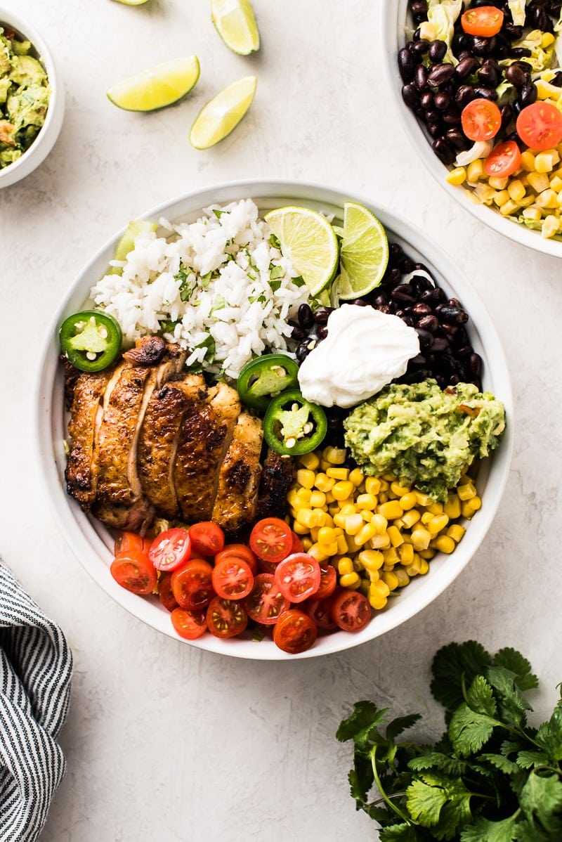 This Chicken Burrito Bowl is easy to make, healthy and perfect for taking to lunch! It's loaded with juicy chicken, rice, black beans, corn and more!