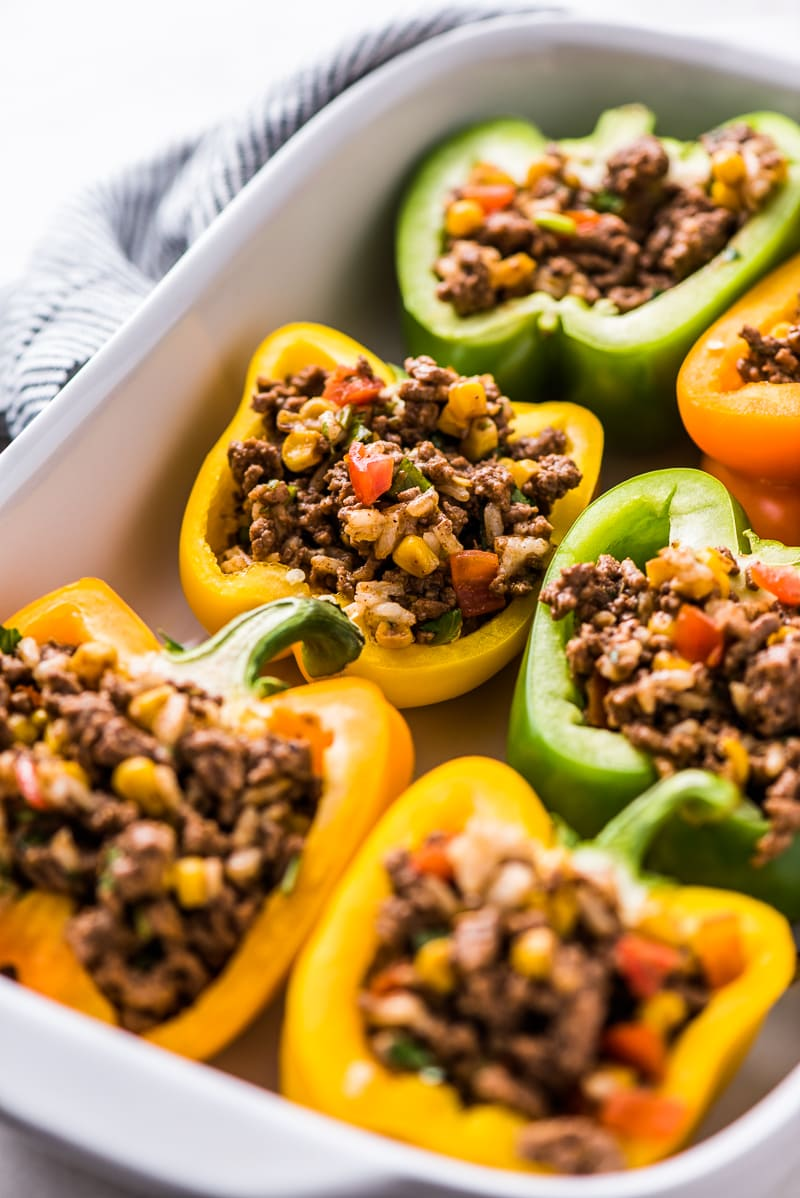 Easy Stuffed Peppers filled with ground beef, chicken or turkey and seasoned with an easy taco seasoning perfect for weeknight meals!