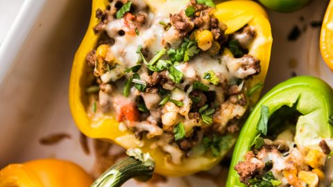 Mexican Stuffed Peppers filled with ground beef, chicken or turkey and seasoned with an easy taco seasoning perfect for weeknight meals!