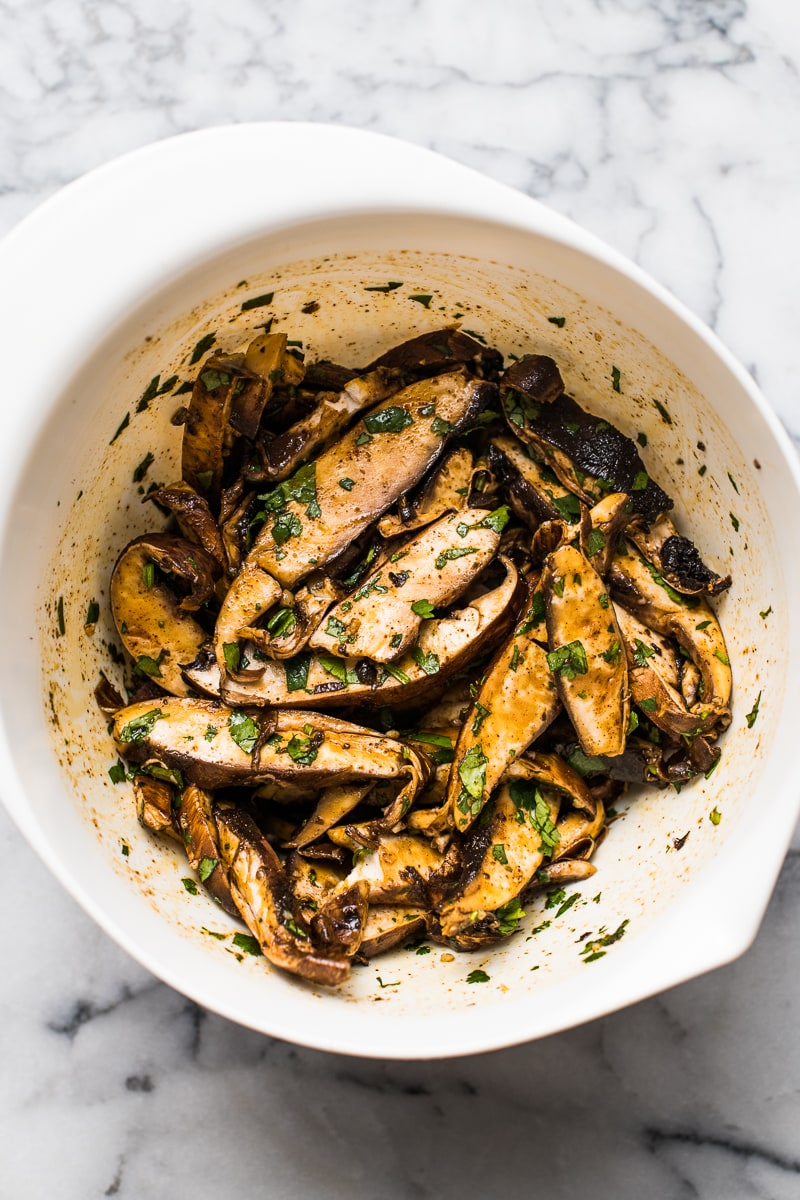 Sliced portabello mushrooms in a lime juice and Mexican spice marinade for vegetarian tacos