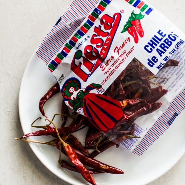 Chile de Arbol Peppers on a white plate.