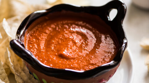 Chile de arbol salsa in an ornate Mexican-style brown bowl.