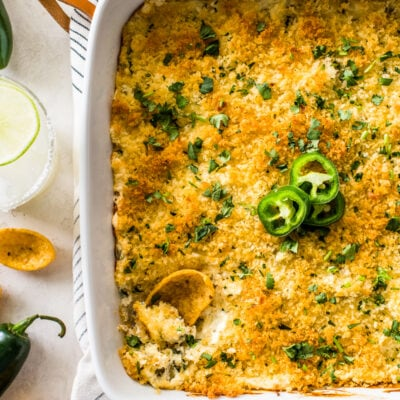 Jalapeno Popper Dip in a white square baking dish topped with crispy golden panko breadcrumbs.