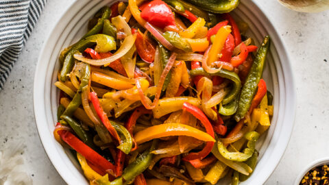 Sauteed Peppers and onions in a white bowl.