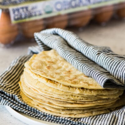 Paleo Tortillas wrapped in a clean kitchen towel.