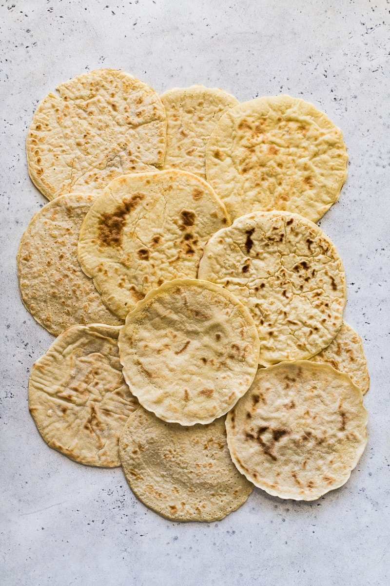Paleo tortillas laid out a blue and white table.