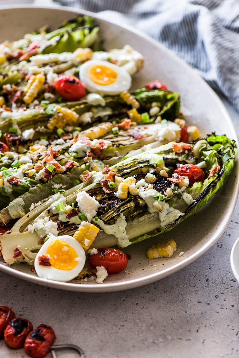 Grilled Romaine salad topped with cotija cheese, corn, tomatoes, hardboiled eggs and jalapeno ranch.