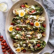 Grilled Romaine Salad on a large platter with jalapeno ranch dressing.