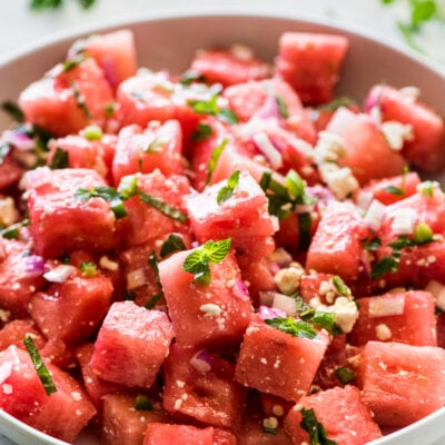 Easy Watermelon Salad topped with mint and crumbled feta cheese