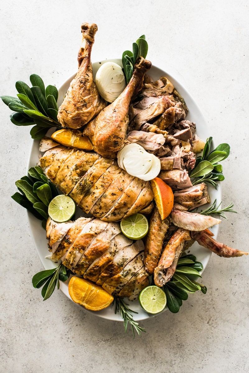 An herb roast turkey that has been carved for Thanksgiving and the holidays.