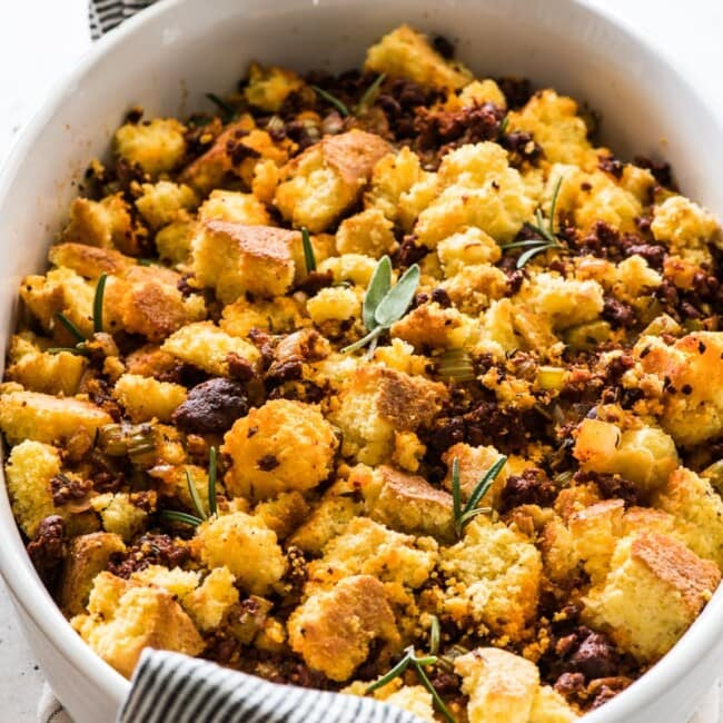 Cornbread stuffing topped with chorizo and fresh herbs.