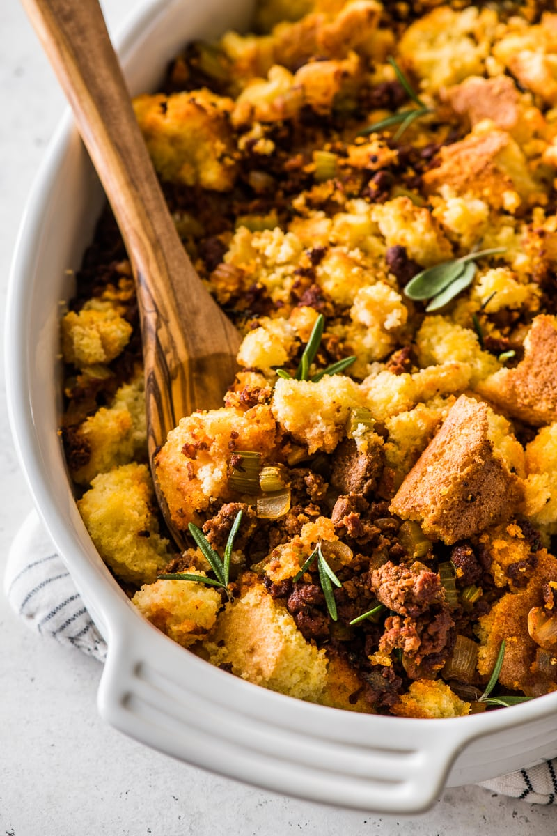 Chorizo cornbread stuffing topped with fresh herbs.