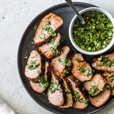 This Grilled Pork Tenderloin is an all-time grilling favorite! Rubbed with a blend of smoky spices like chipotle powder, ground cumin and smoked paprika, this recipe makes unbelievably juicy pork every single time. #porkrecipes #grillingrecipes #porktenderloin