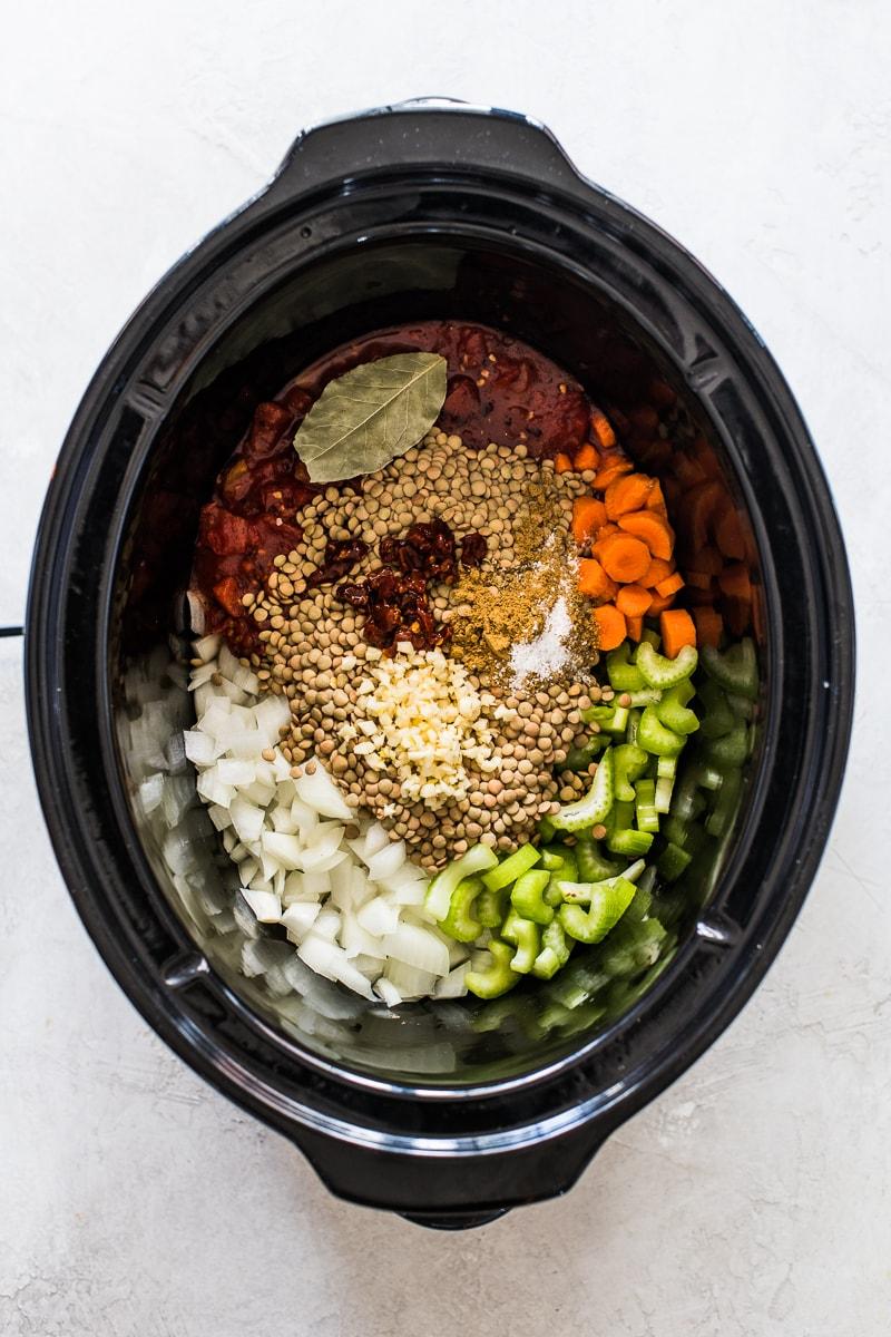 Lentil soup ingredients in a slow cooker