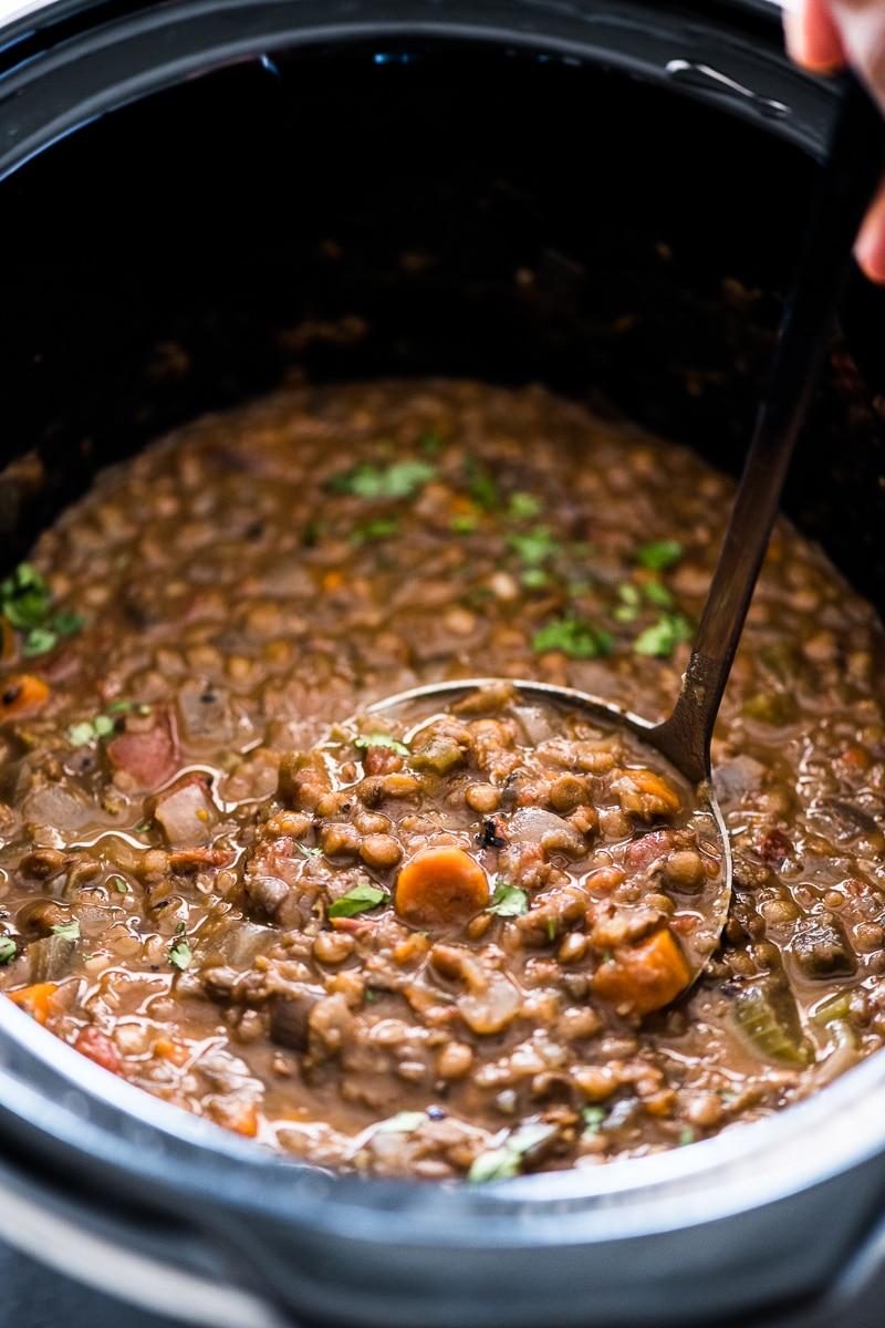 A ladle full of crockpot lentil soup