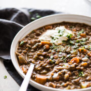This Crockpot Lentil Soup is easy to make, budget-friendly, hearty and satisfying! Made with dried lentils, chopped vegetables, pantry spices, chipotle peppers in adobo sauce and broth, it's naturally gluten free, vegetarian and vegan. #crockpot #slowcooker #lentilsoup #soup