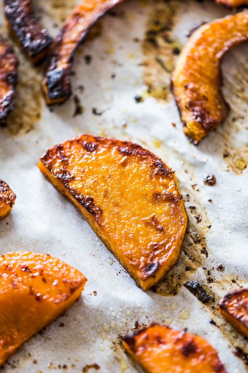 Roasted butternut squash on parchment paper.
