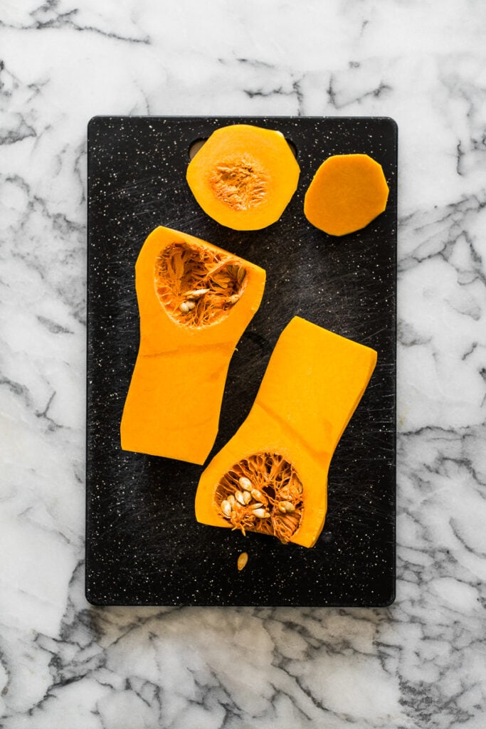 A butternut squash sliced in half lengthwise.