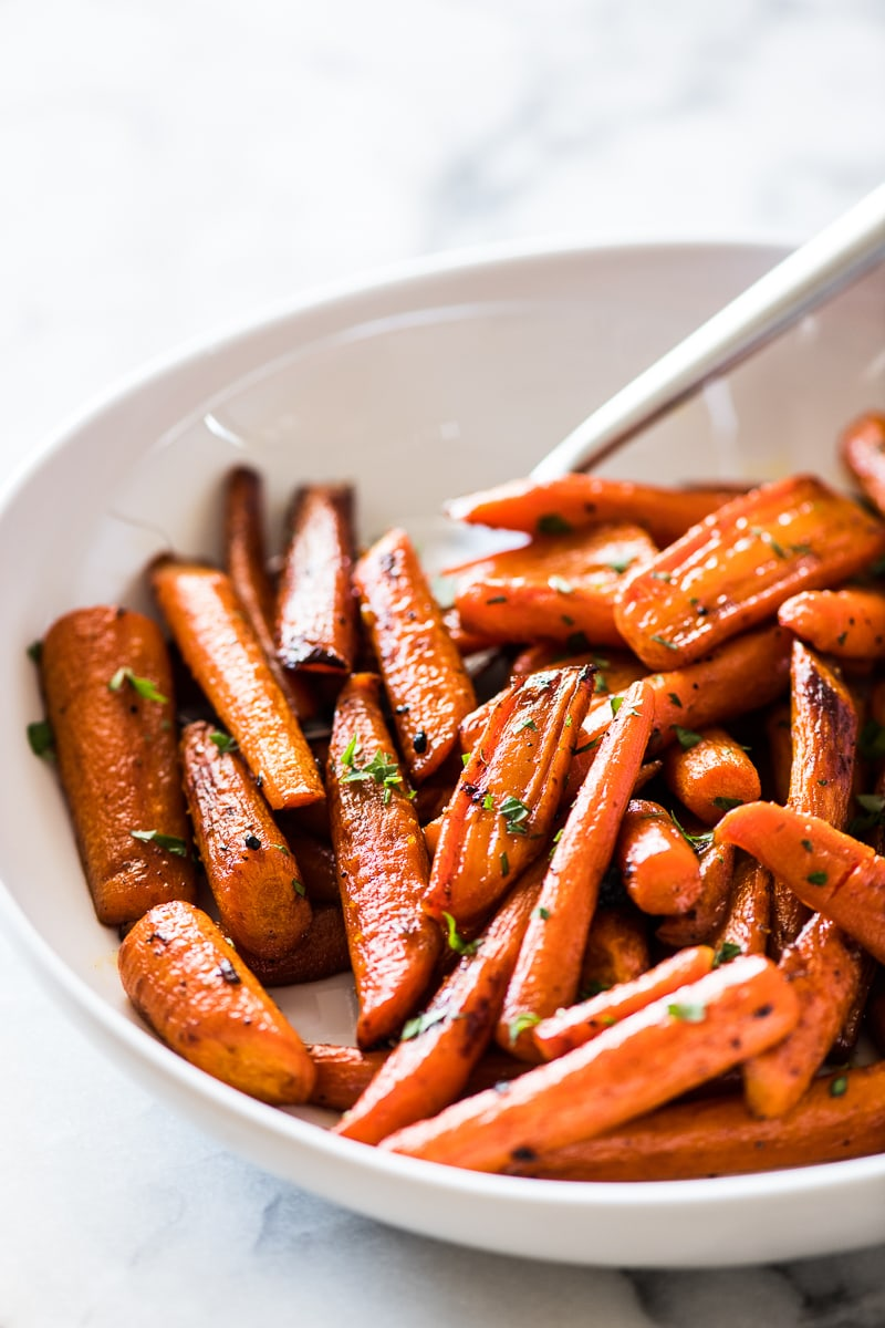 Oven roasted carrots topped with maple syrup and cinnamon
