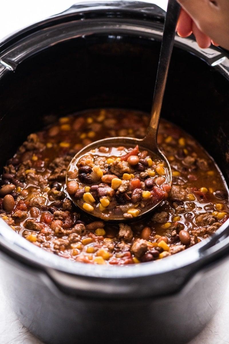 Crock pot taco soup in a ladle