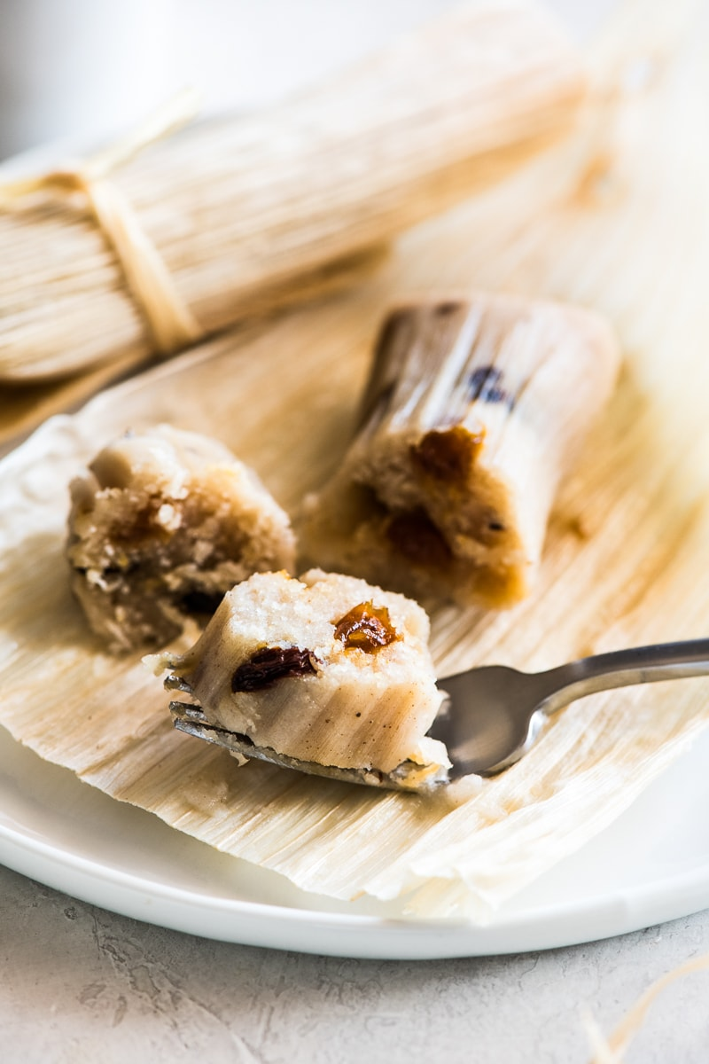 A slice of sweet raisin tamales on a fork.