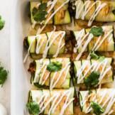 Zucchini Enchiladas topped with sour cream and cilantro