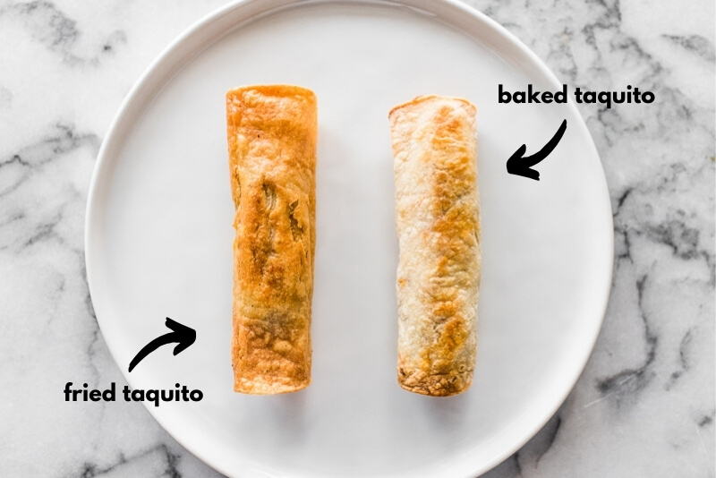 A fried taquito and a baked taquito side by side on a plate