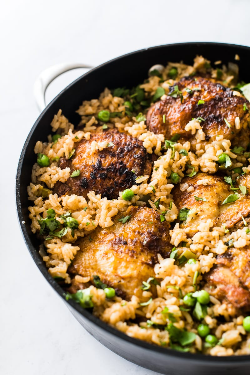 Arroz con pollo with chicken thighs and peas
