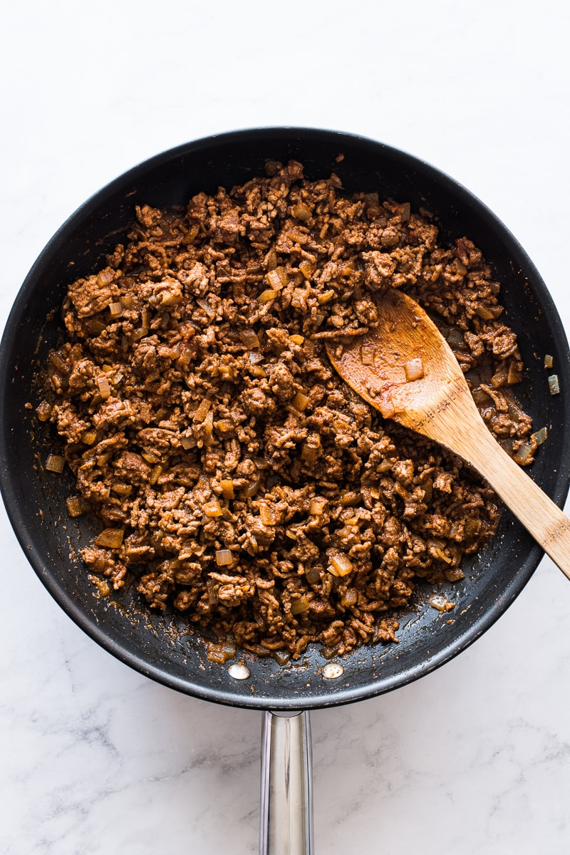 Seasoned ground beef in a skillet for hard shell tacos