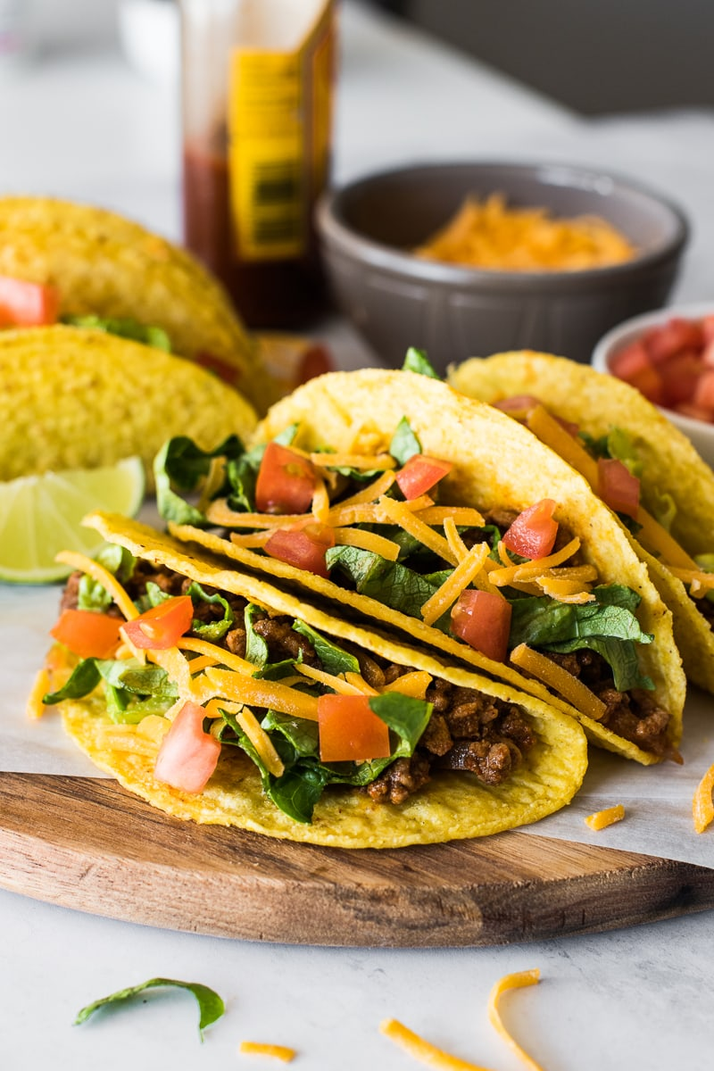 Hard shell tacos filled with ground beef and cheese.