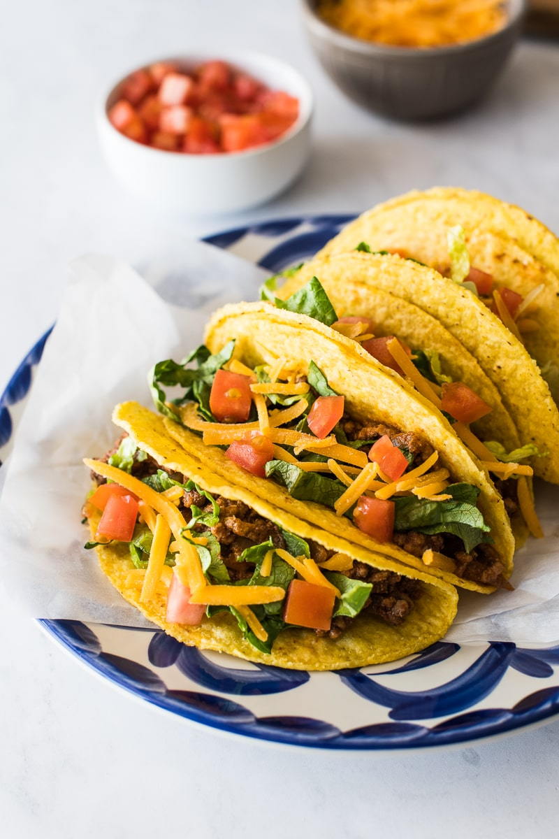 Hard shell tacos on a plate ready to be served.