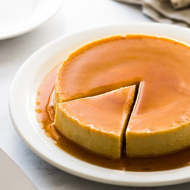 Flan on a plate with a slice cut out