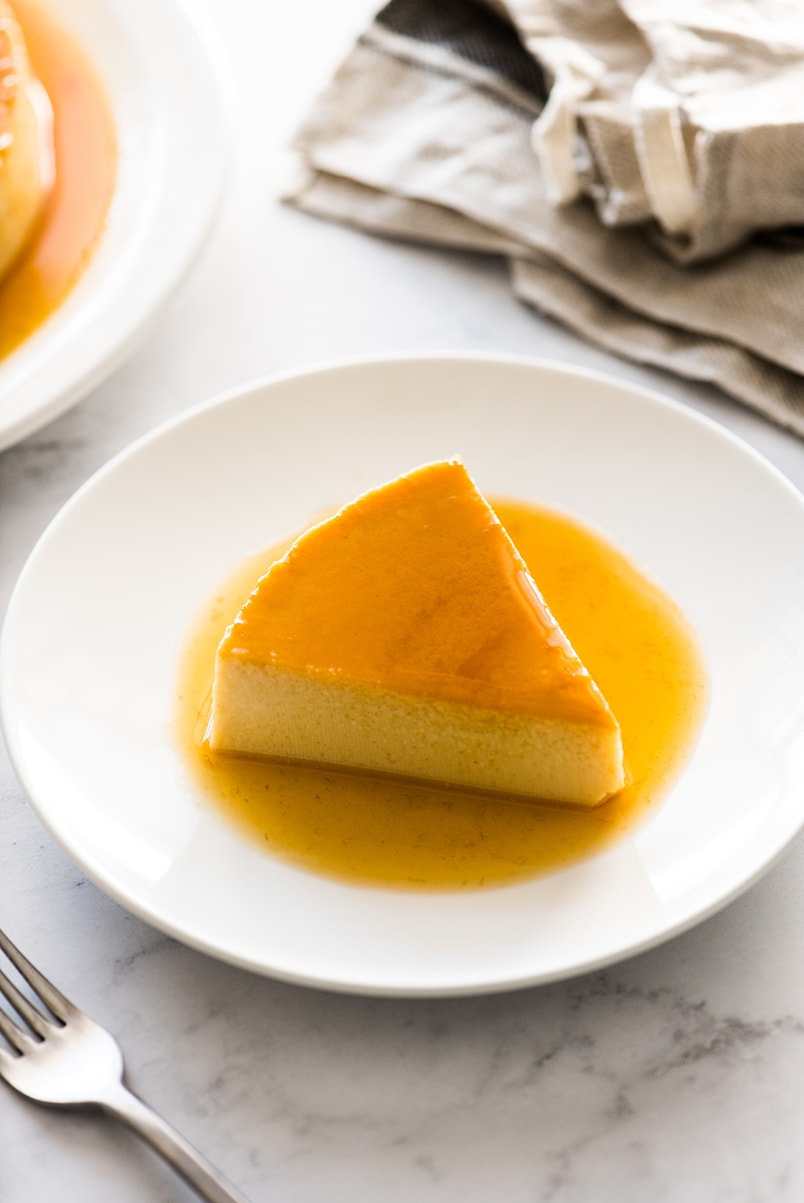 A slice of flan on a table