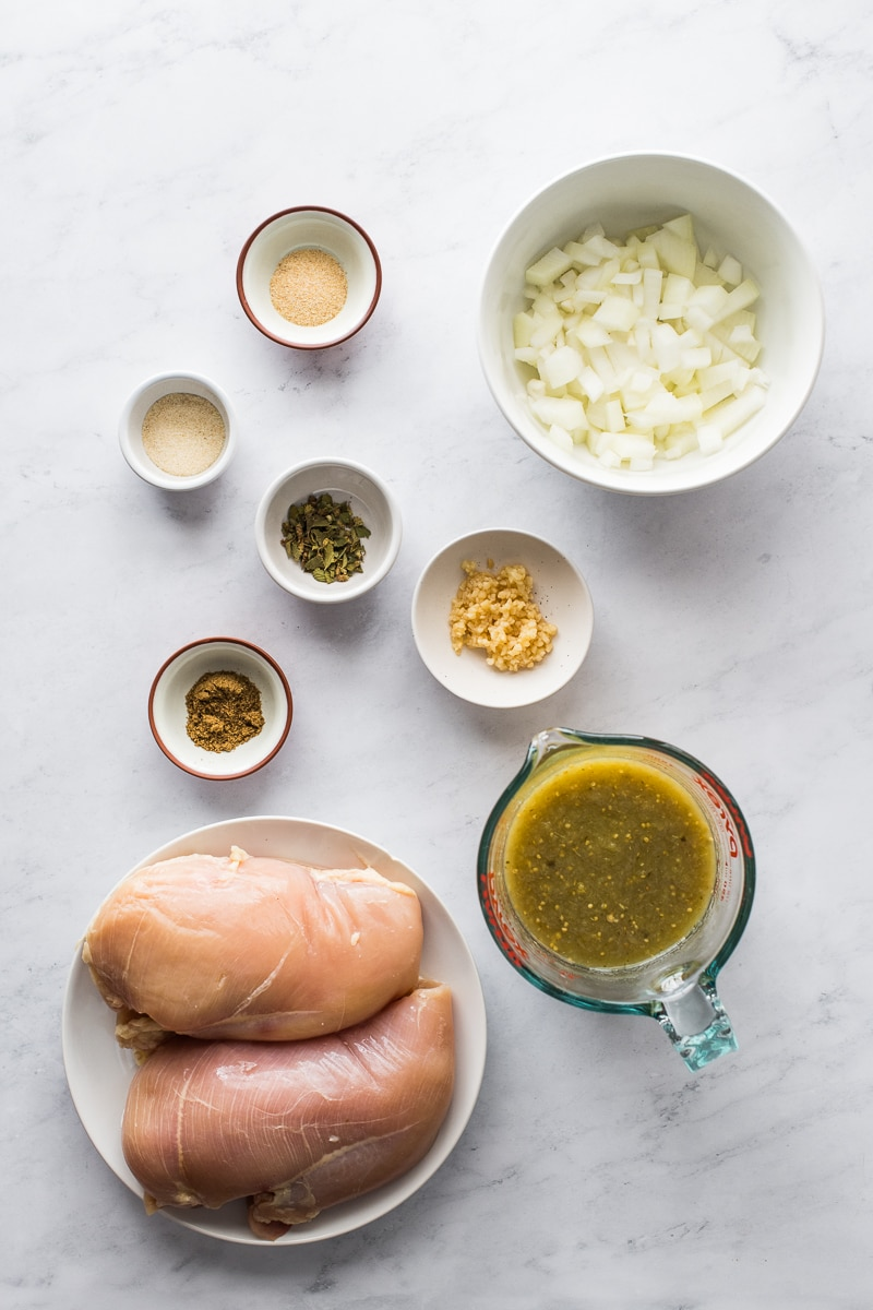 Ingredients in salsa verde chicken on a table