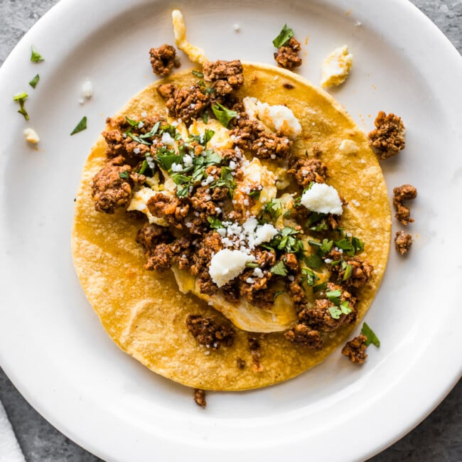 A taco filled with chorizo and scrambled eggs.