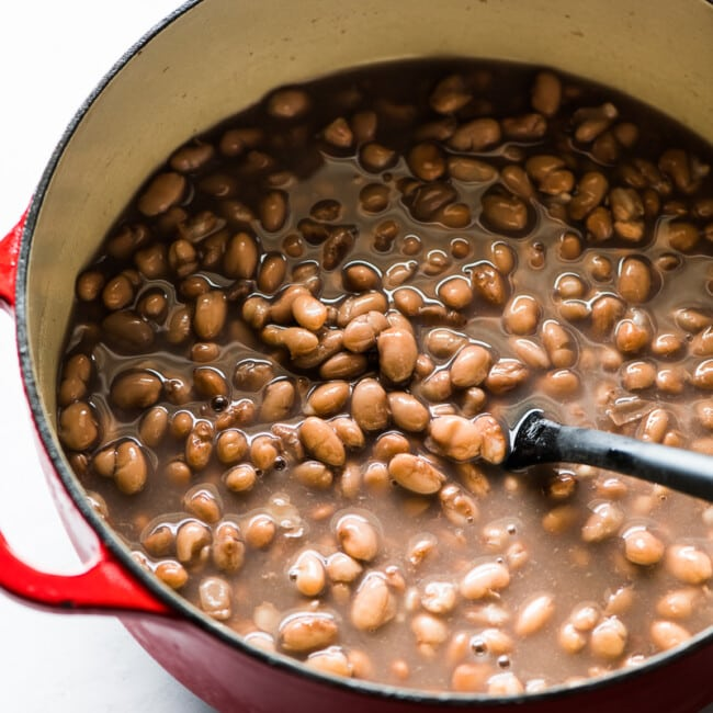 Cooked pinto beans in a pot.