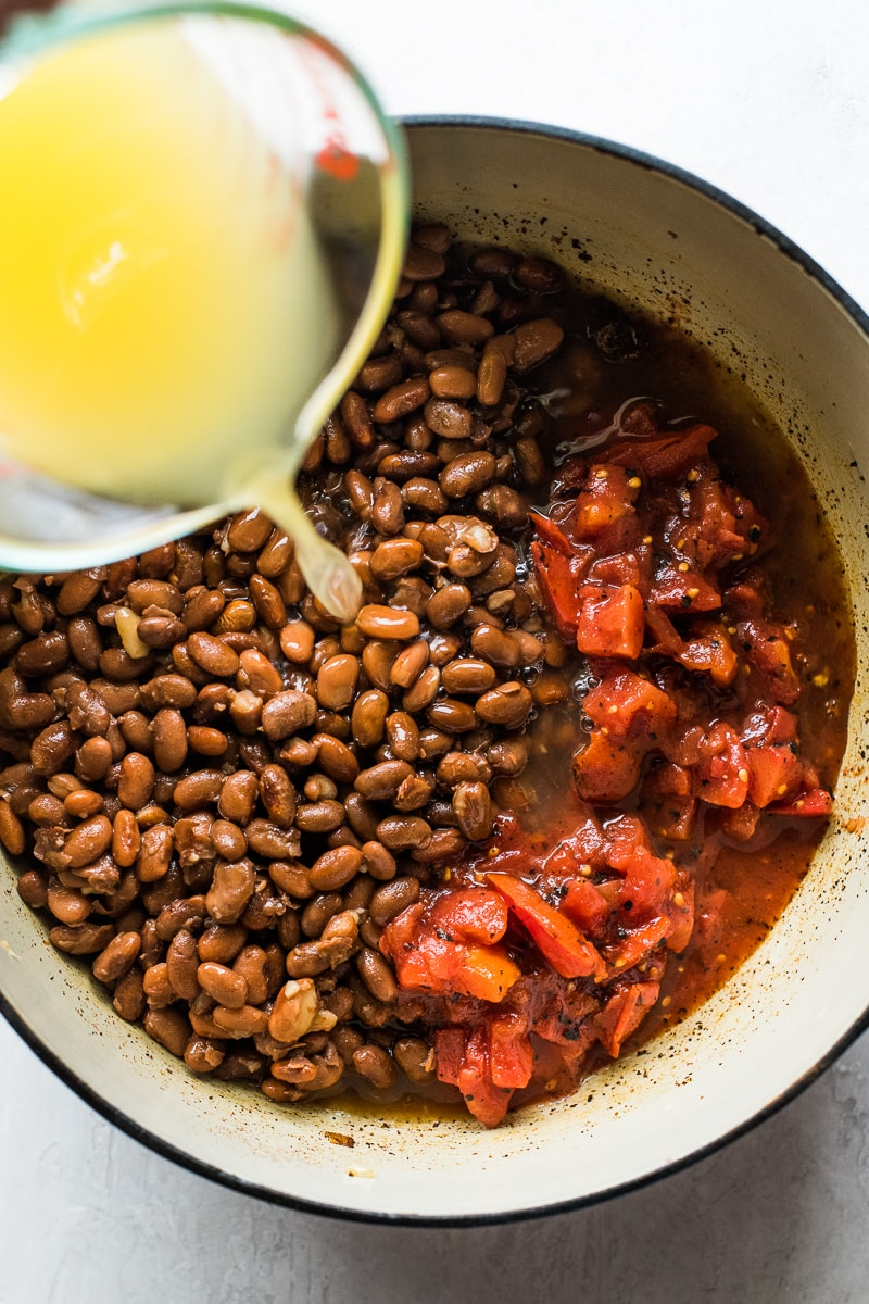 Pinto beans and diced tomatoes in a pot