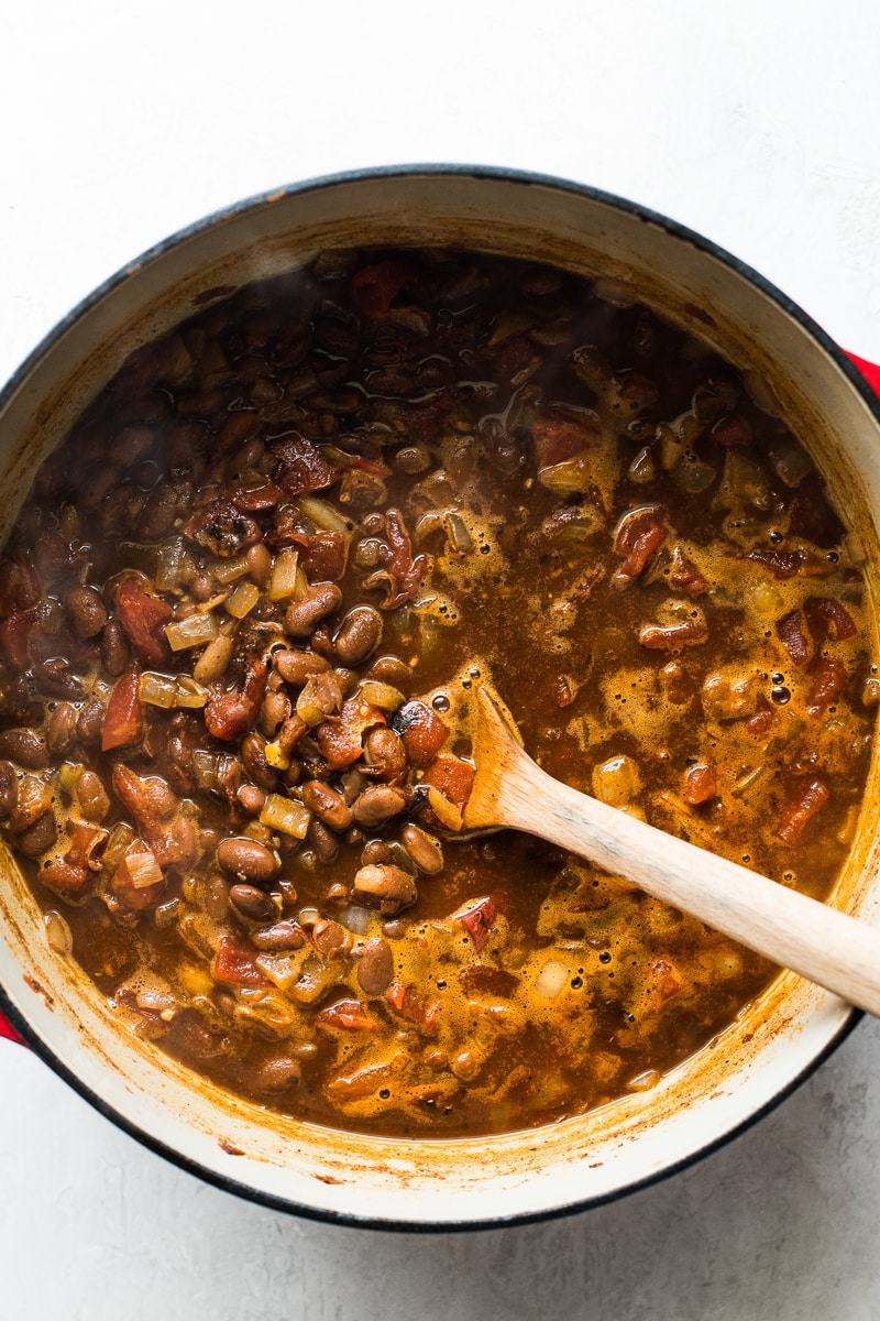 Stirring pinto bean soup in a pot